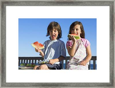 Children Eating Watermelon Framed Print by Lawrence Lawry