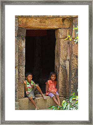 Children In The Doorway. Framed Print by David Freuthal
