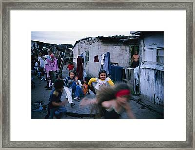 Children Play Around An Abandoned Framed Print by Pablo Corral Vega