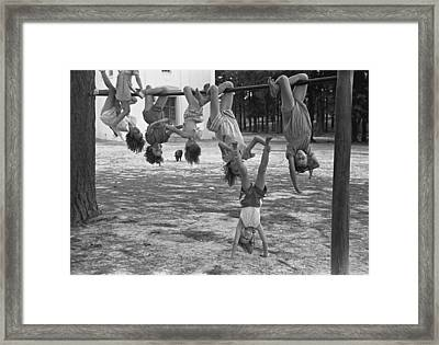 Children Playing At A Playground Framed Print by Everett