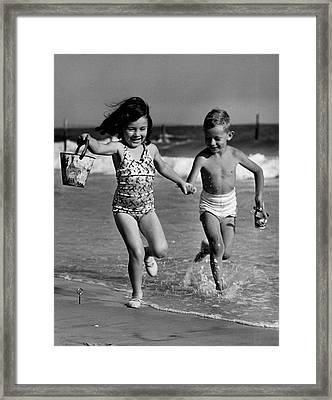 Children Playing At Seashore Framed Print by George Marks