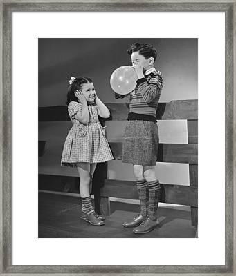 Children Playing With Ballons Framed Print by George Marks