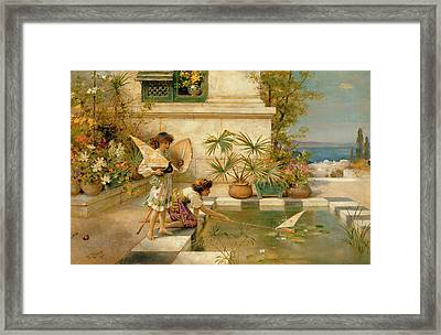 Children Playing With Boats Framed Print by William Stephen Coleman