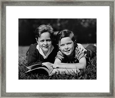 Children W/ Book Outdoors Framed Print by George Marks