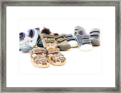Children's Footwear Framed Print by Tom Gowanlock