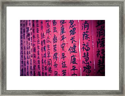 Chinese Characters Written On Red Paper Framed Print by Eastphoto