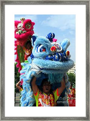 Chinese Lion Dancers In Taiwan's Southern City Of Kaohsiung Framed Print by Yali Shi