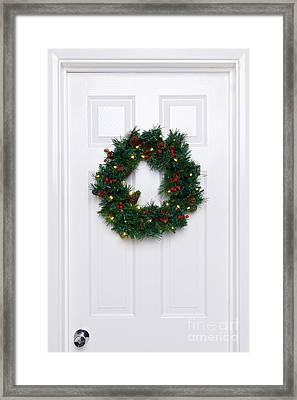 Chrismas Wreath On A White Door Framed Print by Richard Thomas
