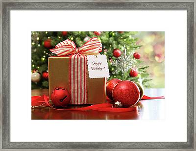 Christmas Gift Sitting On A Table  Framed Print by Sandra Cunningham