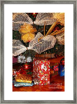 Christmas Giving Framed Print by James Brunker