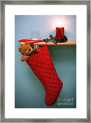 Christmas Stocking Filled With Presents With Empty Milk Glass.  Framed Print by Richard Thomas
