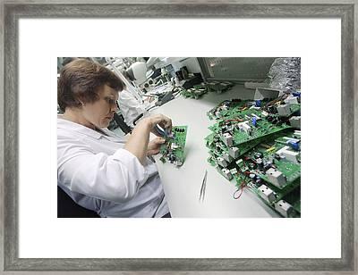 Circuit Board Assembly Work Framed Print by Ria Novosti