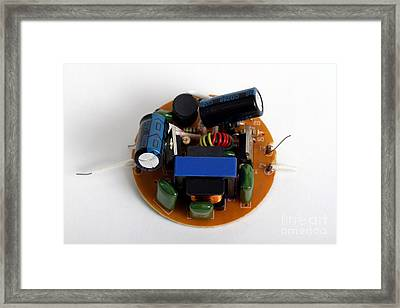 Circuit Board Of Light Bulb Framed Print by Photo Researchers, Inc.