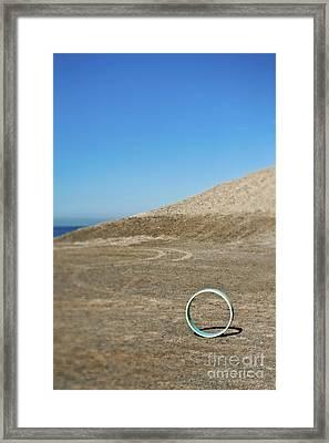 Circular Object On Beach Framed Print by Eddy Joaquim