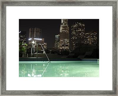 City Skyline At Night Photgraphed From A Pool Framed Print