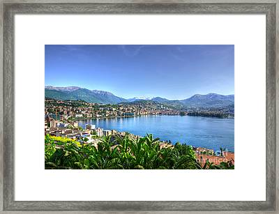 Cityscape With Lake And Mountain Framed Print by Mats Silvan