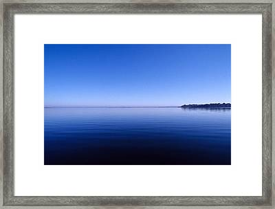 Clear Blue Sky Reflected In A Still Framed Print by Jason Edwards