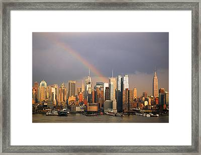 Framed Print featuring the photograph Clearing Skies Over Manhattan by James Kirkikis