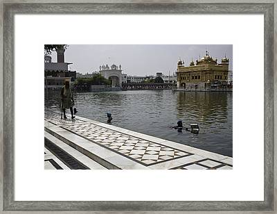 Framed Print featuring the photograph Clearing The Sarovar Inside The Golden Temple Resorvoir by Ashish Agarwal