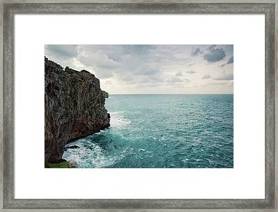 Cliff Line And Stormy Mediterranean Sea Framed Print by Guido Mieth