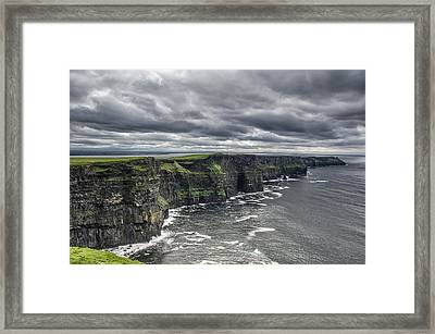 Cliffs Of Moher Framed Print by John Mee