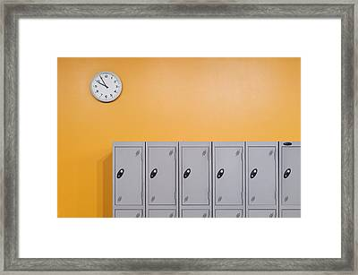 Clock On An Orange Wall Above Lockers Framed Print