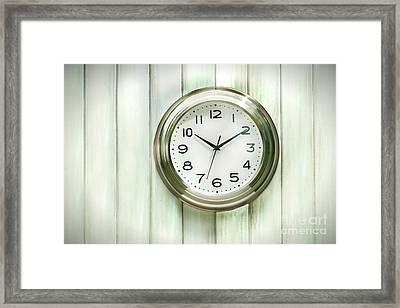 Clock On The Wall Framed Print by Sandra Cunningham