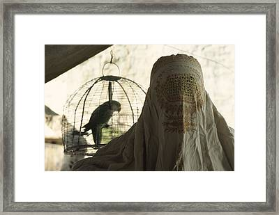 Close-up Of A Woman And A Parakeet - Framed Print by James L. Stanfield