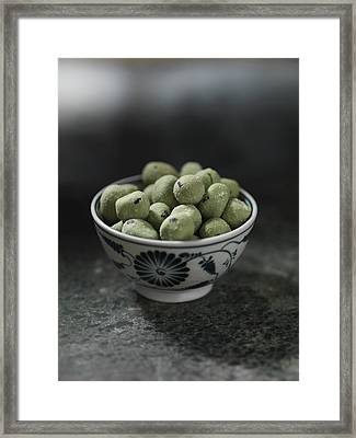 Close Up Of Bowl Of Wasabi Peas Framed Print by Diana Miller