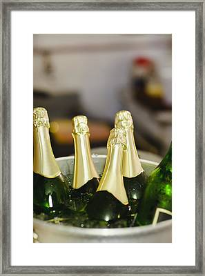 Close Up Of Bucket Of Champagne Framed Print by Hybrid Images