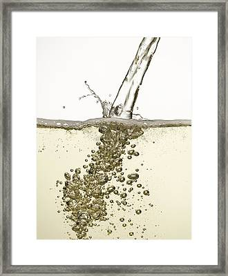 Close Up Of Champagne Being Poured Framed Print by Andy Roberts
