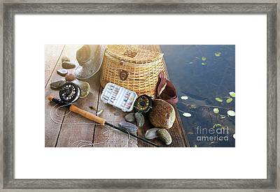 Close-up Of Fishing Equipment And Hat  Framed Print