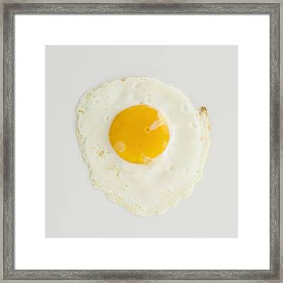 Close Up Of Fried Egg, Studio Shot Framed Print by Jamie Grill