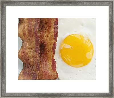 Close Up Of Fried Egg With Bacon, Studio Shot Framed Print by Jamie Grill