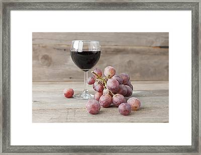 Close Up Of Grapes And Glass Of Wine Framed Print by Stefanie Grewel
