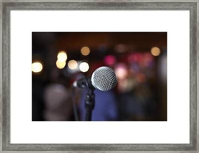Close Up Of Microphone On Stage In Lights Framed Print