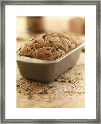 Close Up Of Rustic Bread In Loaf Pan Framed Print by Adam Gault