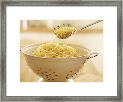 Close Up Of Spoon Scooping Spaghetti In Colander Framed Print