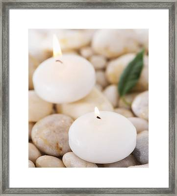 Close Up Of Tea Lights And Green Leaf On Pebble Stones, Studio Shot Framed Print by Daniel Grill