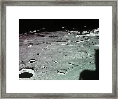 Close-up Of The Craters On The Surface Of The Moon Framed Print by Stockbyte