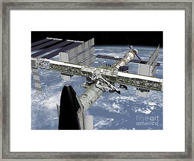 Close Up View Of The Shuttle Docked Framed Print by Stocktrek Images