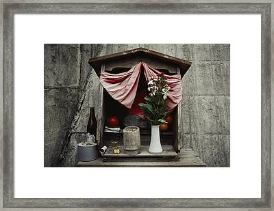 Close View Of A Shrine With Oferings Framed Print by Sam Abell