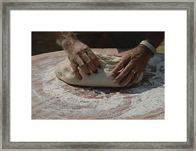 Close View Of Hands Kneading Bread Framed Print