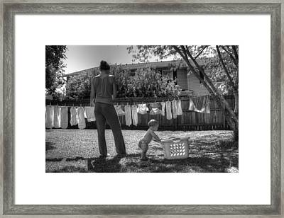 Cloth Diapers On The Line Framed Print by Justin Ellis