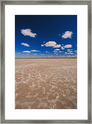 Clouds Float In A Blue Sky Above A Dry Framed Print by Jason Edwards