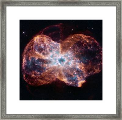 Clouds Of Gas And Debris Surround Framed Print by ESA and nASA