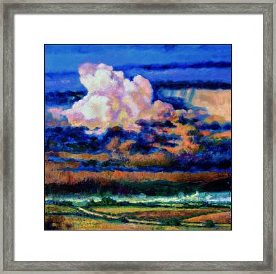 Clouds Over Country Road Framed Print by John Lautermilch