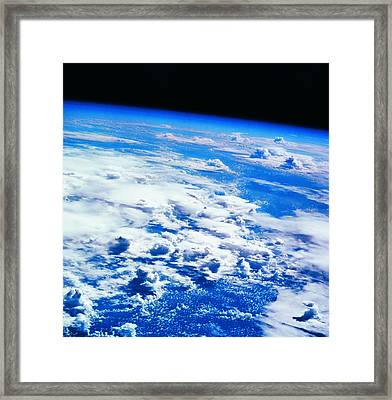 Clouds Over Earth Viewed From A Satellite Framed Print by Stockbyte