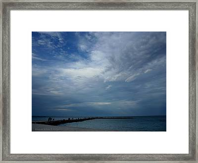 Clouds Over The Jetty Framed Print by Grace Dillon