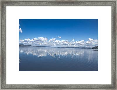 Clouds Over Water Framed Print by Julie Smith